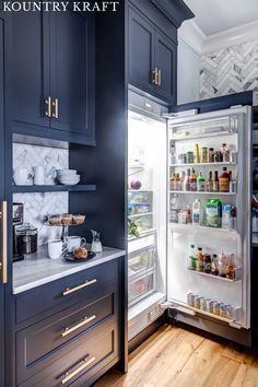 Personalize your kitchen with navy kitchen cabinet. We have a lot of ideas to see from this Stunning Navy Kitchen Cabinets Ideas You Have Must See. Navy Blue Kitchen Cabinets, Navy Cabinets, Metal Kitchen Cabinets, Painting Kitchen Cabinets, Kitchen Interior, Kitchen Decor, Kitchen Design, Refrigerator Cabinet, D House