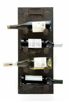 """$99 'Rustic Rack' This natural wood wine rack holds 4 bottles and comes in multiple colors. Made from a beautiful piece of reclaimed wood and designed to be available in a variety of sizes as well. If you would like another size, please send a custom request form which you can find under the item listing. 25""""x10""""x9"""". Protective stain and rusted nails. www.etsy.com/listing/165606505/rustic-wine-rack?ref=shop_home_feat_2 #WoodSculpture #Contemporary #Art #YustArt #wine #vino"""