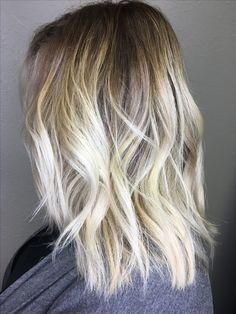 Blonde Balayage! Dark roots with bleach blonde ends. Medium length hair. Beach waves.