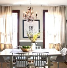 Wood trim around windows, yet dining room is still light and bright