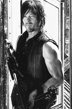 Daryl Dixon ... Walking Dead!..something about his dirtiness, scrubbiness, scruffiness looking mess, makes him hot.