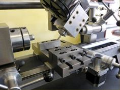Stepperhead Universal Machine Tool. Designed and built by Alan Jackson, the Stepperhead is an attempt to combine, in one unit, the range of facilities found in a medium sized lathe and a small vertical/horizontal milling machine.