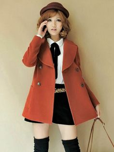 Stylish button up coat in burnt orange.  Features twin pockets.