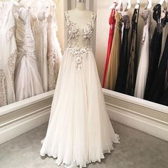 A new #PninaTornai design has arrived to @kleinfeldbridal  I'm in love with this sheer corseted gown and these floral embellishments.  Pnina