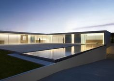 "Residential Architecture: Casa del Atrio (Atrium House) by Fran Silvestre Arquitectos: ""..Almost everything that goes on inside this house in Valencia, Spain by Fran Silvestre Arquitectos is on show to visitors though a transparent glass facade..The L-shaped house is entitled Casa del Atrio, or Atrium House, in reference to the glazed elevation and skylight that bring light into the eastern wing..A large living/dining room occupies this space and offers residents a view out over…"