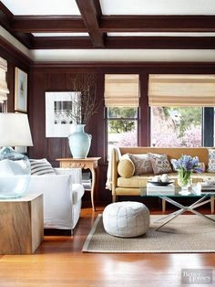 Continue the feeling of fall thanks throughout the living room with cream-colored upholstery, exposed wood and cut tree branch arrangements.