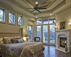 OMG this is dream, although I do not like the bed(headboard), I love the openess of the room, all the natural light and the fireplace is IT!..I love the tray celings and of course my hardwood!
