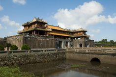The Gate House of the Forbidden Purple City in Hue, Vietnam Purple City, Gate House, Royalty Free Images, Hue, Vietnam, Stock Photos, Mansions, House Styles, Building