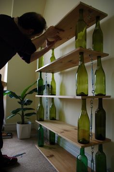 Reuse empty wine bottles by creating this sleek, gorgeous bookshelf