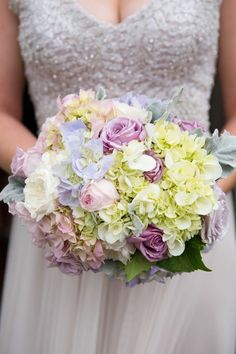 Jane Hill wedding gown with soft romantic flowers, roses, hydrangea