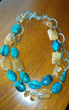 Turquoise, sterling silver and agate double strand necklace. $84.00