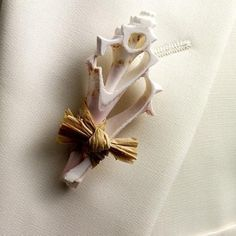 So classy and natural - shell boutonniere
