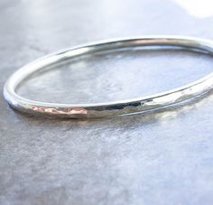 Weighty 8 Gauge Hammered Silver Bangle Choice of by KatAndMuse, $58.00