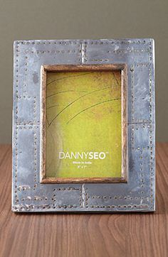 Constructed with reclaimed wood and steel, Danny Seo's studded frame makes recycling chic.