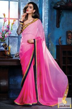 Be the graceful charming diva after attiring this pink georgette party saree with designer blouse. A fancy attire is alluring with yellow and golden embroidery.  Rs2020