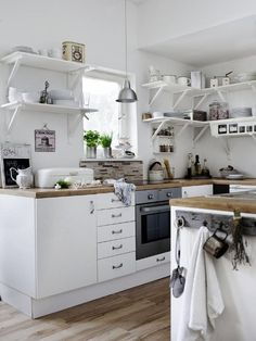 Love the white kitchen and wood countertop!