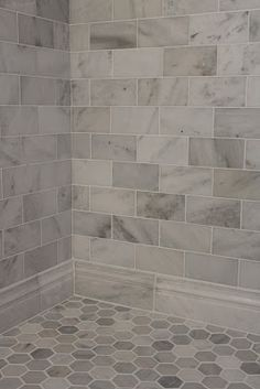 Large gray and white marble subway tile on shower wall and baseboard with a hexagon pattern on the floor. Large gray and white marble subway tile on shower wall and baseboard with a hexagon pattern on the floor. Upstairs Bathrooms, Dream Bathrooms, Tiled Bathrooms, Small Bathrooms, Gray Tile Bathrooms, Cottage Bathrooms, Master Bathrooms, Small Kitchens, Downstairs Bathroom