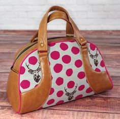 A modern twist on a retro design, this largehandbag sewing pattern is the perfect fit for any Bombshell Betty.