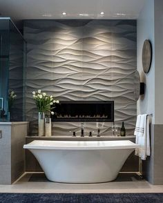 Absolutely gorgeous bathroom with an amazing focal point wall using tile from @artistic_tile ❤️