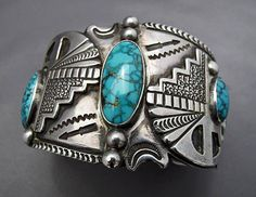 """Vintage Fred Harvey Era bracelet  by Morris Robinson showing influence of """"tourist"""" symbol stamps posted in Fred Harvey study group"""