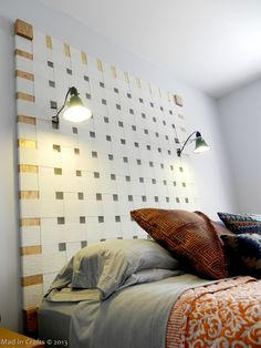 DIY Headboard with Hardware Store Clip Lamp Reading lamps. Spray paint inexpensive clip lamps and use 40 watt fluorescent bulbs made to look like incandescent.