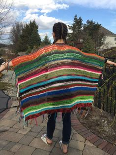 I LOVE this hand crafted unique womens crochet bohemian poncho/Shawl/cape/sweater! Every single one is totally different! If youd like select colors feel free to ask & Ill be happy to make a custom piece.  The poncho pictured is the hip length version but I also make them longer like a duster for an additional cost. Both are super cool for any fun activity youre getting yourself into or for just lounging around.  Each one of these speaks to my inner hippie and I hope they s...