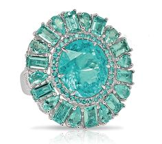 Round Paraiba Cocktail Ring by Sutra - Round cocktail ring features 14.0 cts. t.w. paraiba including a round center framed in round accent stones, and further decorated with a border of emerald and pear-shape paraiba tourmalines. MSRP: $115,000