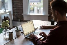 Seven Ways To Make Your Office Happier - Man Working On Laptop On Desk