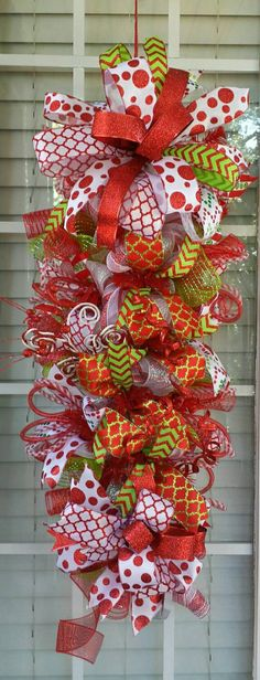 Check out this item in my Etsy shop https://www.etsy.com/listing/252044743/christmas-deco-mesh-teardrop-swag-wreath