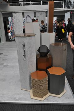 Hexagonal plinths made of mdf and honeycomb board. Copper vinyl tops. VCG Colourlink at the VM & Display 2016. Specialists in large format printing, window displays, fabric printing, light boxes and installation.