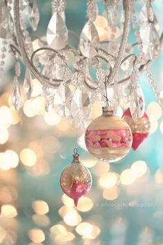 Vintage ornaments on a chandie... Beautiful...