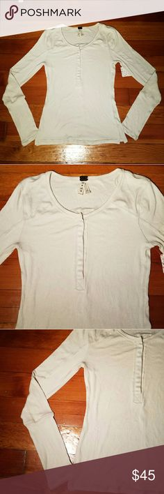 NWT Free People ribbed long sleeve henley NWT Free People ribbed long sleeve henley with snaps, raw edges. Super stretchy. Called: Layering Me. Color name: Wheat Open to offers. Free People Tops Tees - Long Sleeve