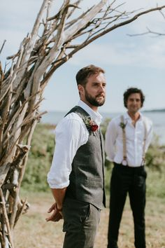 Handsome groom awaiting his bride at their boho beach wedding ceremony in Maine   Image by  Emily Delamater Photography