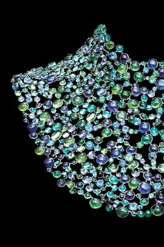 This powerful necklace celebrates the convergence of air, earth, water and fire in an exuberant explosion of color. Fashioned from platinum with cabochon and faceted stones, including blue and green tourmalines, tanzanites, iolites, apatites and fancy color sapphires.