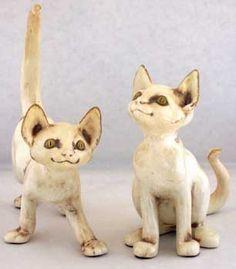 Freeman-McFarlin pottery of California made many cat models  1950's
