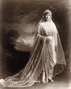 Satin dress (bridal portrait), circa 1916. This gown was worn by the donor's mother, Elizabeth Mary Branch Simons Chisolm at her wedding.  Via Charleston Museum, flickr.
