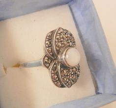 Beautiful sterling ring circa seventy's has a retro art deco style design. Almost looks to me like a layered lotus and all accented in sparkling