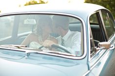 San Luis Obispo, Dana Powers Barn Wedding, bride and groom sitting in classic Jaguar kissing in front seat, car from Cars With Distinction  // Cameron Ingalls photography