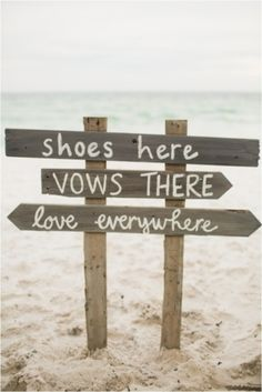 A sunny soiree and a sign in the sand. We love this idea for a beach wedding.