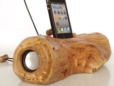 iPhone 4 music dock, iPod music dock - from log, sync, charge, installed speakers, can serve as holder / stand. $250.00, via Etsy.
