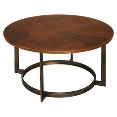 Round metal coffee table with an aged copper-finished top. Product: Coffee tableConstruction Material: Metal