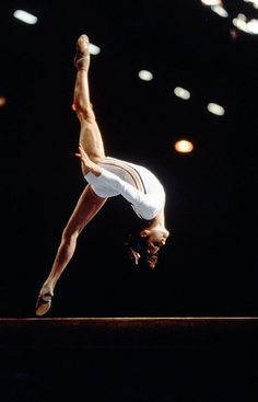 Nadia Comaneci of Romania completes a somersault during the 1976 Summer Olympics in Montreal. Comaneci was the first gymnast to ever be awarded a perfect score in an Olympic gymnastic event, and in total, won three gold medals in Montreal.