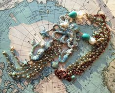 August Challenge, Necklace #2, B'Sue octopus, mermaids, starfish and shell in aqua copper with ice enamels and very old Japanese rosary chain, vintage shell and glass beads. MockiDesigns.etsy.com
