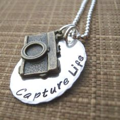 I love this!!! Really goes with my photography passion! Capture Life hand stamped mixed metal necklace by JLynnCreations, $36.00