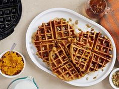 We serve these sweet and spicy Southwestern-inspired Pumpkin-Chipotle Waffles with an orange and cayenne infused maple syrup for a citrus kick.