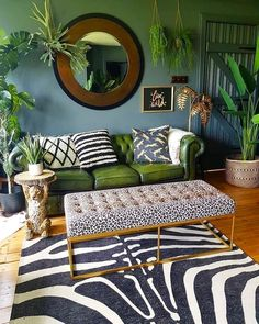 A Story of Home – donwpipe walls, green leather chesterfield sofa leopard print bench zebra rug and plants -interiors inspiration for lovers of dark scandi boho Bohemian Interior Design, Interior Design Living Room, Living Room Designs, Bohemian Decor, Bohemian Style, Boho Chic, Interior Modern, Tropical Interior, Interior Livingroom
