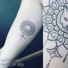Ornamental cat tattoo