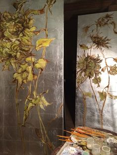 Claire Basler, artist painting on gilded-silver