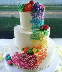 Beautiful buttercream rainbow wedding cake