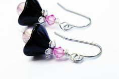 Check out this item in my Etsy shop https://www.etsy.com/listing/193820897/black-and-pink-swarovski-flower-earrings